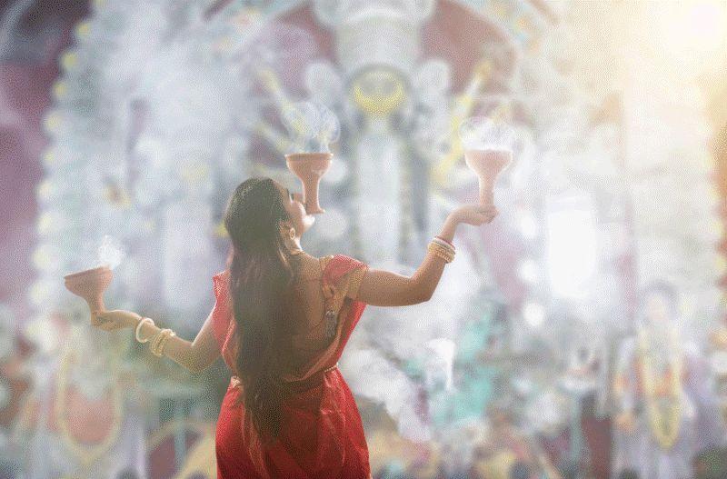 A Lady Performing Durga Puja in Kolkata