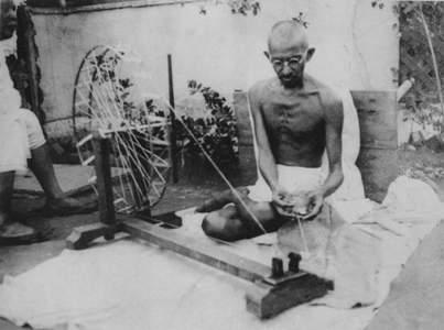 Mahatma Gandhi Spinning A Wheel