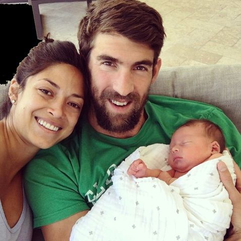 Michael Phelps with his wife and son