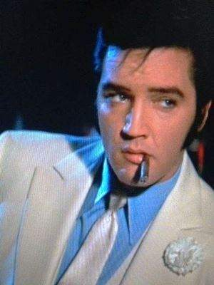 elvis smoking cigar
