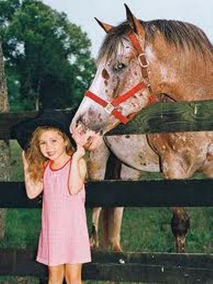 Young Miley with horse