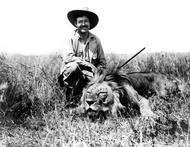 American journalist Ernest Hemingway hunting a lion in 1934