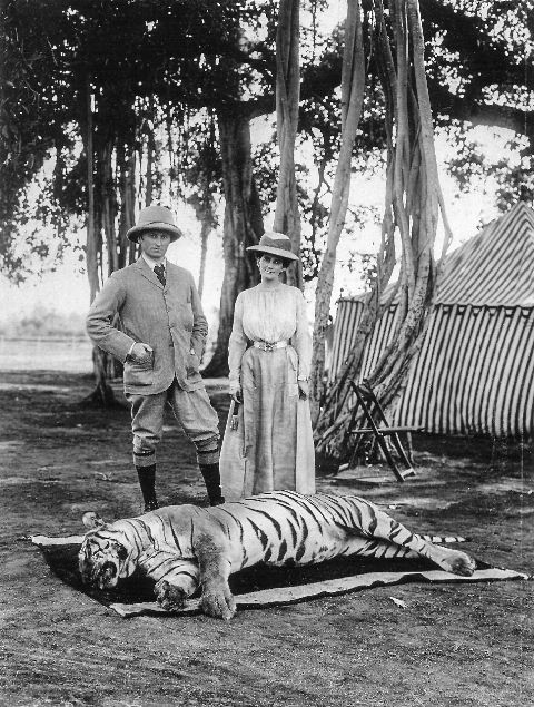 George Curzon with his wife posing with a hunted Bengal tiger, 1903