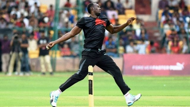 Usain Bolt playing cricket