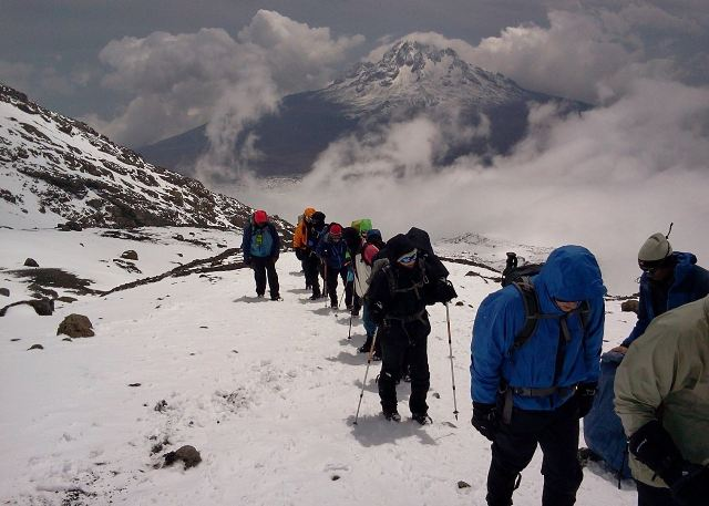 People climbing Mt. Kilimanjaro