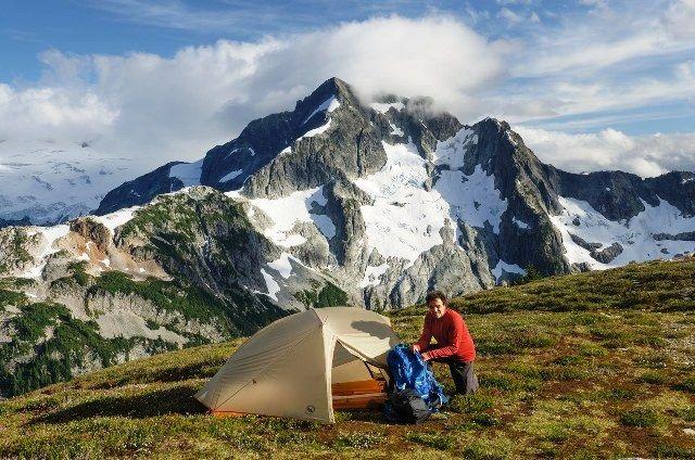 Hiker setting up a camp near the Cascade Pass