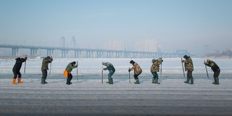 Workers Carving Frozen Songhua River