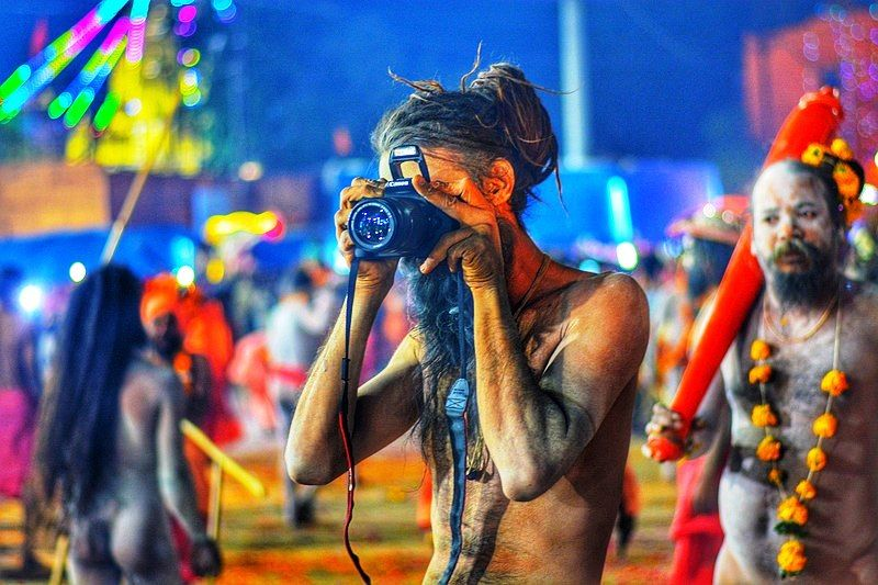 A Naga Sadhu Using A DSLR