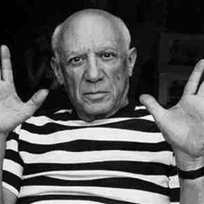 Pablo Picasso wearing his white shirt