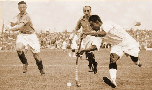 Dhyan Chand (right) playing against France in the 1936 Olympic Games