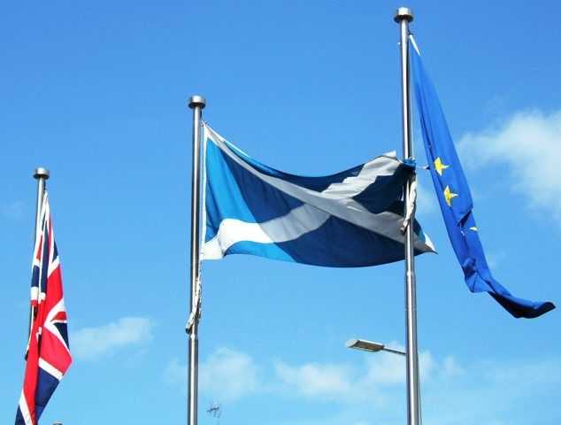 Flag of Scotland between the flag of the European Union and the Union Jack