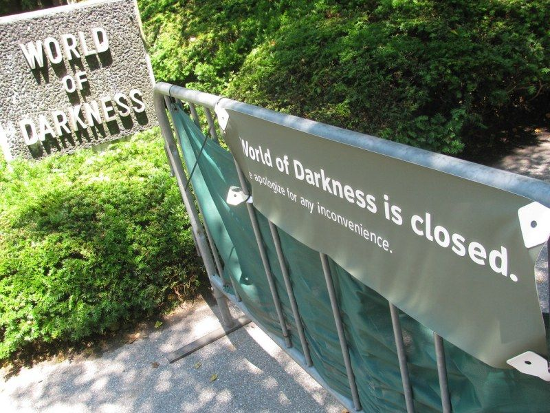 A Banner in Bronx Zoo Showing The World of Darkness is Closed